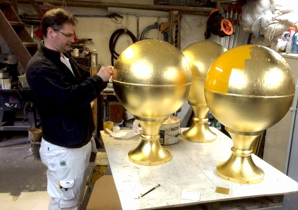 Gold Leaf applied to the podium spheres at Hampton Court Palace